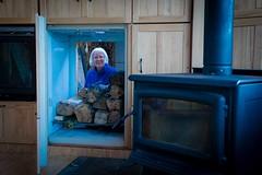 ShirlEh plays peek-a-boo through the wood pile door.