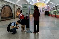 Pyongyang Metro: People reading the Newspaper (fvfavo) Tags: newspaper metro kp northkorea dprk nordkorea kangwon