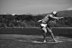 DSC_0021 (Travis Schuldt) Tags: blackandwhite beach water monochrome sport washington seaside movement sand outdoor pacificnorthwest pnw skimboarding bnw skimboard skimming belingham