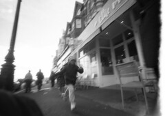 Run (4foot2) Tags: street leica longexposure people blackandwhite bw blur film coffee monochrome 35mm mono kid experimental child candid voigtlander grain streetphotography rangefinder wideangle running run motionblur 35mmfilm soviet streetphoto 15mm peoplewatching reportage filmgrain streetshot expiredfilm slowexposure reportagephotography bexhill kbr filmphotography 2015 oldfilm caffenol printfilm interestingpeople outofdatefilm russianfilm 111f voigtlander15mm washingsoda vitc svema svemafn64 potassiumbromide fn64 leica111f caffenolcm 4foot2 candidportrate 4foot2flickr 4foot2photostream fourfoottwo