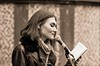 Apollinarya Orlova reading her poetry, Canterbury (chrisjohnbeckett) Tags: apollinaryaorlova poet poetry reading canterbury street urban sepia portrait people monochrome culture ukc literaturesociety universityofkent chrisbeckett canonef135mmf2lusm notebook global photojournalism performance performer