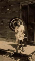 Umbrella Lady (~ Lone Wadi ~) Tags: africanamerican blackwoman frontporch umbrella unknown retro 1920s roaring20s
