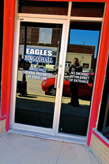 Eagles Lodge #2442, Shoals, IN (Robby Virus) Tags: shoals indiana eagles lodge fraternal organization foe order building sign signage door bingo hall glass reflection selfportrait aerie 2442