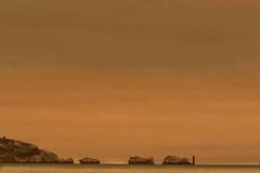 NEEDLES LIGHT (EXPLORED) (mark_rutley) Tags: hampshire needles sunset lighthouse rocks sea solent thesolent