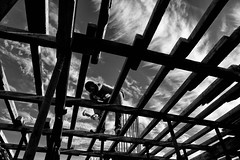 Man at work (Saman A. Ali) Tags: street streetphotography stphotografia streetlife blackwhite blackandwhite bw people socialdocumentary documentary dailylife fujifilmxt1 fujinon16mmf14 building monochrome abstract architecture lines diagonal structure