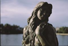 20150914-image001_1 (Ron Buening) Tags: film water statue female contrast analog zeiss nude 50mm fuji shadows florida bokeh bayou carl fujifilm zeissikon ikon provia 250 tarponsprings provia100f planar 100f zm f20