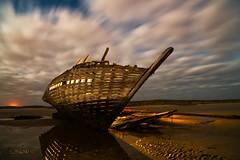 Left to its own fate. (darklogan1) Tags: longexposure nightphotography beach clouds boat tide logan wreck lightpaint darklogan1