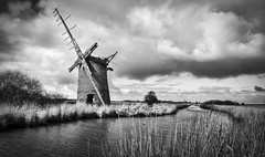 Brograve mill windpump (chrissmithphotos1) Tags: old travel vacation england white mill tourism reed water river landscape countryside canal nationalpark wind norfolk ruin peaceful nobody historic pump sail riverbank viewpoint tranquil horsey dilapidated ruined drainage broads windpump norfolkbroads broadland brograve horseywindpump