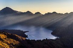 The last rays of light (Jannik Peters) Tags: light sunset sun mountain lake cold reflection beautiful indonesia landscape volcano warm mt view sony illumination atmosphere 55mm crater rays fe rim mystic indescribable rinjani a7r