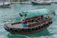 ABERDEEN, HONGKONG, OCT 21 2016: small boats and fishing boats parked at the storm shelter. The Aberdeen Fishing Village Hong Kong. (suphachai_lonuchit) Tags: aberdeen aerial bay black boat building china chinese city cityscape cloud cloudy cyclone day downtown finance grey harbor harbour hong hongkong island kong landmark landscape mist modern monsoon ocean rain rainy scene sea season ship sky skyline storm tourism tower town travel typhoon typhoons urban victoria view water weather white