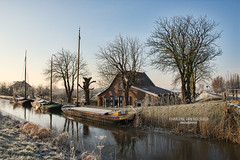 Three Boats in a Row (Charlene van Koesveld) Tags: three boats boat sailboat water waterfront waterscape frozen ice frost cold trees row house maasland landscape city grass winter dew nikon pittoresque picturesque morning middendelfland nature reflection dutch netherlands nederland holland southholland travel europe village