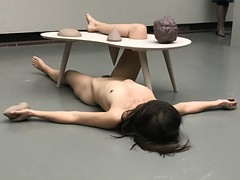 Naked woman and a table