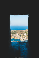 Through the fortress (Nicola Pezzoli) Tags: favignana sicilia sicily island egadi summer sea water colors nature canon tourism fortress village sunset golden hour blue