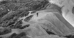 Undulations (kurjuz) Tags: ghajntuffieha malta qarraba blackandwhite clayslopes curves hikers lightandshadow lowsun undulations