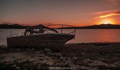 Forgotten (Edorta_AS) Tags: sunset espaa sun lake landscape lago boat spain nikon long barco vasco euskadi esposure vitoria pais gasteiz d5100