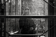 Trapped In Black And White (Alfred Grupstra) Tags: bw backlight blackandwhite people station street streetphotography streetlife woman hoorn noordholland nederland nl