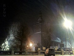 snowy evening by the church (Ola 竜) Tags: street evening dusk streetlamp light trees xmastree illumination church wooden building tower architecture car sidewalk dark night lamppost lensflare city urban lightsnow snowy snowing composition