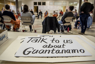Talk to Us About Guantanamo - Protest Signs Lay on a Table Near a Witness Against Torture Meeting