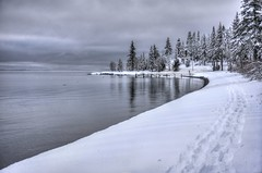 Serene beauty of Lake Tahoe winter (PeterThoeny) Tags: tahoecity laketahoe california water lake shore reflection waterreflection snow snowshoe tracks day cloudy cloud 2xp raw nex6 photomatix selp1650 hdr qualityhdr qualityhdrphotography serene outdoor fav200