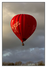 Up, Up and Away (Audrey A Jackson) Tags: canon60d hotairballoon colour red sky clouds advertising autumn sunshine lakedistrict 1001nightsmagiccity