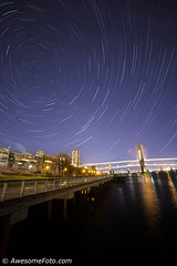 Startrails at riverside (james c. (vancouver bc)) Tags: startrails night sky tower park tree lights outdoor river riverside riverbank abstract arcs astronomic astronomy astrophotography celestial circle exploring harmony idyllic motion polaris city rotation serenity space star starry trace trail tranquil tranquility universe north water pier newwestminster canada building apartment highrise bridge skytrain highway pierpark lighttrail cable scene urban