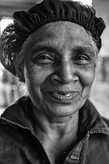 Tea Lady (alisdair jones) Tags: ef35mmf14lusm woman face hairnet portrait kandy srilanka