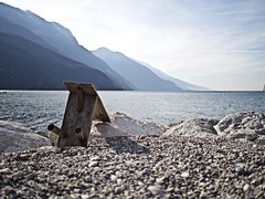 Empty chair (Mastrox) Tags: lago di garda lake water mountain montagna chair sedia wood legno winter inverno sunny soleggiato prime lenses mirrorless olympus penf 17mm