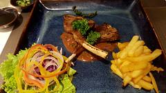 Lambchop treat (Roving I) Tags: food salad bars gravy chips meat vietnam fries lamb dining chops parsley danang avatarresortspa