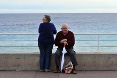 Promenade des Anglais (BrianGeorgeM) Tags: auto street travel sea man france beach french photography pc nice nikon couple mediterranean riviera elderly promenade cote f25 dazur 105mm d700 desanglais