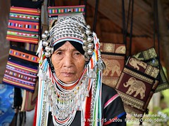 2015-11f Akha (04) (Matt Hahnewald) Tags: facingtheworld asia banpaoonanglae northernthailand adult akhawoman akhaheaddress akhavillage tribal travel traveldestination tourism ethnic ethnicminority ethnology colour chiangrai worldcultures costume ethnotourism eyecontact female nikond3100 silvercoins oldwoman stringsofbeads thaihilltribe wrinkles headshot photography ©matthahnewaldphotography ethnicportrait livedinface 43aspectratio oneperson primelens asian humanface nikkorafs50mmf18g photo image horizontalformat flashfired builtinpopupflash village colourful beautiful tribalwoman traditionalgarment cultural character personality human humanhead mouth facialexpression consent friendly empathy rapport encounter emotion mood travelportrait humaneyes closeup street 50mmlens fullfaceview