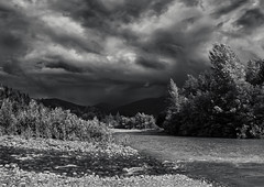 Approaching Thunderstorm (martincarlisle) Tags: thunderstorms mamquamriver massitercreek squamish britishcolumbia canada seatoskyhighway highway99 rivers streams creeks rocks trees confluence hills sky clouds storms sunlight pentaxk5 pentaxart pentaxians tamronlenses blackandwhite monochrome wow nwn