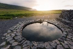 hot spring bath waiting for you (Franziska Liehl) Tags: sunset spring water sun europe old beautiful evening green warm peaceful sunny relax round circle bath lagoon bathing volcanic quiet iceland historic relaxing enjoy thermal hotspring midnightsun geothermal warmingup grettislaug