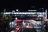 Night Moves (hidesax) Tags: nightmoves crossing passersby cars signal red train keihintohokuline yamanoteline tokyo japan hidesax sony a7ii leica summicronm 50mm f2