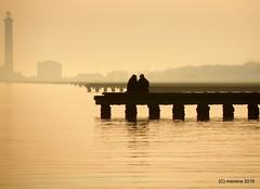 Atmosphere (martinasirena) Tags: jesolo veneto italy jesolobeach sunset foggy mist atmosphere pinklight couple silhouette dock pier buildings landscape seascapes seascape sea