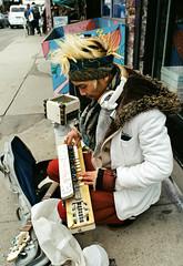 New Toy (Georgie_grrl) Tags: kensingtonmarket pentaxk1000 rikenon12828mm toronto ontario hangingoutwithmondo jasongold musician newtoy instrument talented