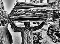 make a livin' (Greyframe) Tags: rag bone ragnbone firewood carry living life market bangalore bangaluru urban poverty hard man street black white greyframe monochrome grey photography blackwhite blackandwhite bw blwh schwarz weiss schwarzweis people poor india indien trip