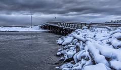 Bridge (Paul Rioux) Tags: bc vancouverisland colwood westshore westcoast esquimaltlagoon bridge snow ice rocks logs clouds outdoor cold season winter prioux