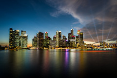 Singapore (Mopple Labalaine) Tags: singapore marinabay marinabaysands skyline skyscraper night lightshow water bay boat longexposure cityscape tamronsp17mmf35