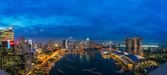 Cityscape of Singapore (anekphoto) Tags: singapore marina bay sands night skyline city business waterfront sky landscape beautiful modern tourism light building travel blue architecture district urban asia cityscape landmark tower skyscraper downtown asian hotel twilight casino water outdoors scene river famous panorama bridge helix reflection space evening tourist park central commercial dusk structure bar rooftop