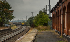 Freight liner class 66/5 no 66514 approaches the disused old Edwinstowe Station on 31-08-2015 with empties bound for Thoresby Colliery Sidings (kevaruka) Tags: summer color colour colors rain clouds canon countryside flickr colours rainyday cloudy shed rail railway august mining 5d railtour frontpage dull britishrail nottinghamshire dbs colliery miningtown thoresby edwinstowe canonef24105f4l cloudyday 2015 class66 drearyday ews networkrail railfreight 66514 railnetwork dbschenker canon5dmk3 5dmk3 5d3 thoresbycolliery 5diii canoneos5dmk3 thoresbypit ilobsterit edwinstowestation 31082015