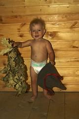 DSC09181 (arthur_streltsov) Tags: portrait baby smile hat children eyes bath babies child sony blueeyes broom sauna alisa bathhouse childportrait sonyalpha sonylens sonykit sony1855 sonya290