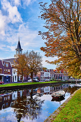 Canals - Weesp (Vlad photos) Tags: street city bridge flowers autumn trees light sky cloud plant building tree brick fall cars church nature water grass leaves architecture clouds reflections garden outside lights restaurant boat exterior waterfront outdoor bricks perspective silhouettes canals foliage vehicle serene weesp nex7