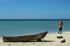 IMG_2852 (Rickard Nilsson) Tags: caribbean sea ocean blue shore beach nautic boat wood woodboat orange man walk haiti fishing life culture portsalut village canon travel texture contrast canon700d 700d 50mm