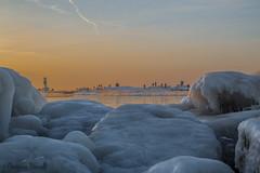Holland Ice Boulders (ChristineDarnell) Tags: ice snow sunset lakemichigan hollandmichigan boulders iceberg christinedarnell canon canoneos6d ef24105mmf4lisusm people lighthouse pierhead