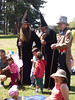 A Hat Trick (Steve Taylor (Photography)) Tags: hats wizard apprentice cane staff fairy fashion park fun people newzealand nz southisland canterbury christchurch newbrighton sunny sunshine costume picnic