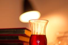 Tea Love (ImSaidoww) Tags: tea lamp light night fantastic read book love shine bokeh deep red nikkor nikon nikond5100 nikonphotography 85mm 18g art