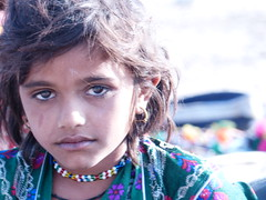 The eyes tell the story (lucknowtrainman) Tags: village girl child shopkeeper bigeyes
