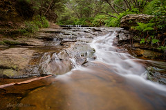 Cascades above Wentworth Falls II [in Explore 25 Feb 2017] (astrogirl969) Tags: fujifilm xe1 samyang12mmf20ncssc wentworthfalls water bluemountains acr nikcolorefex4 adobecameraraw pselements iwps outing outdoor landscape green red rocks nd64 haidandfilters longexposure wideangle 10000views postprocessed 250faves