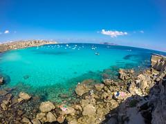 Cala Rossa n02 (Ivan S. Almeida) Tags: sea seaside seascape shore blue water green cristalclear hill serene cloudless sky italy sicily gopro