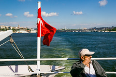 (Abdallah A. Mansour) Tags: street old people man color water ferry canon turkey geotagged boats eos ship candid ships streetphotography oldman places istanbul flags bosphorus tr goldenhorn 550d fujitone